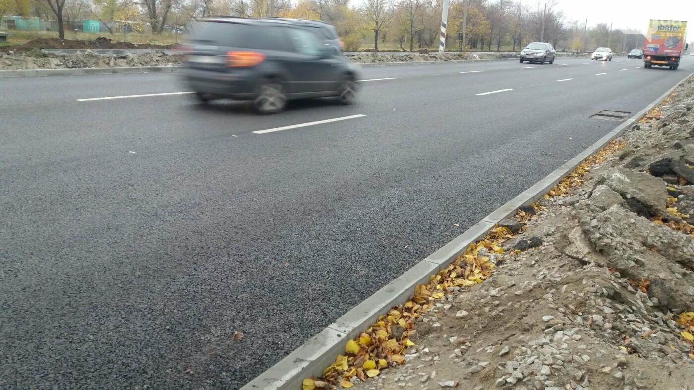 В Запорожье на Набережной открыли движение по отремонтированной дороге: строительные работы продолжаются, — ФОТОРЕПОРТАЖ, фото-1
