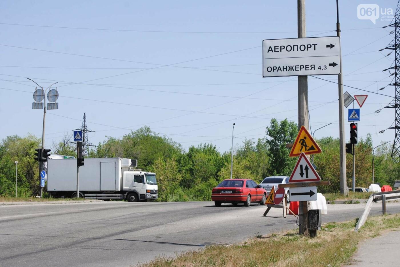 Ремонт моста на трассе в Запорожье: сначала мешали дожди, теперь — жара, - ФОТО, фото-14
