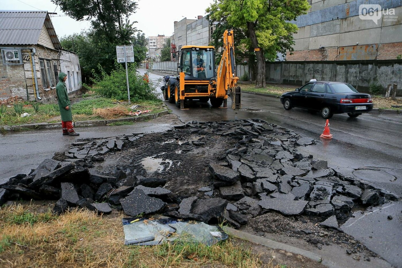 В Запорожье после ливней разрушены дороги: почему это произошло и за чей счет отремонтируют, - ФОТОРЕПОРТАЖ, фото-5