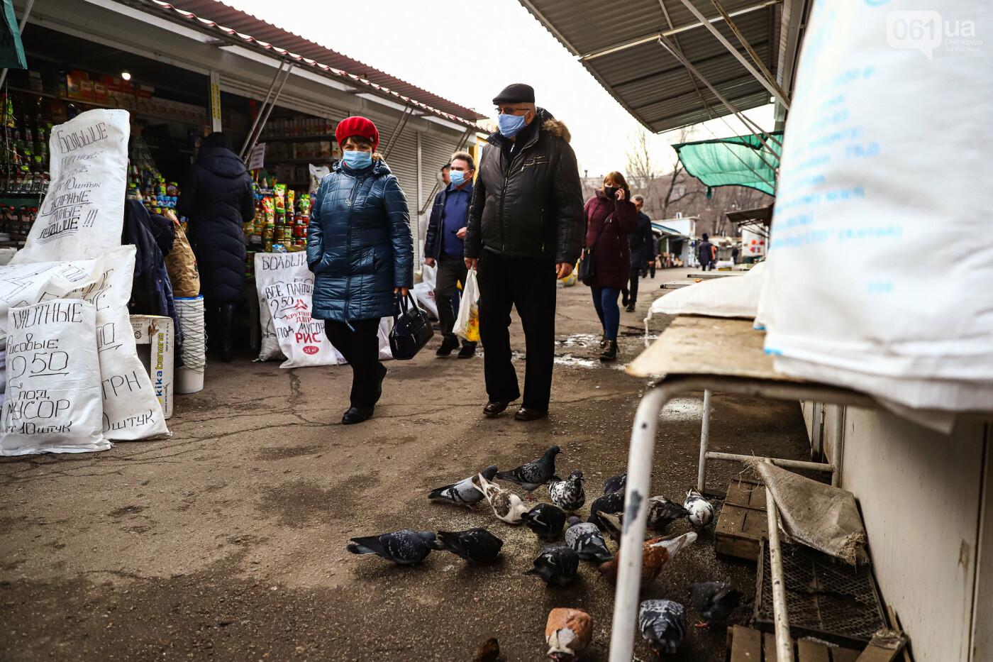 Защитные ленты на товарах, неработающие ТРЦ и полузакрытые рынки – фоторепортаж о первом дне локдауна в Запорожье, фото-14