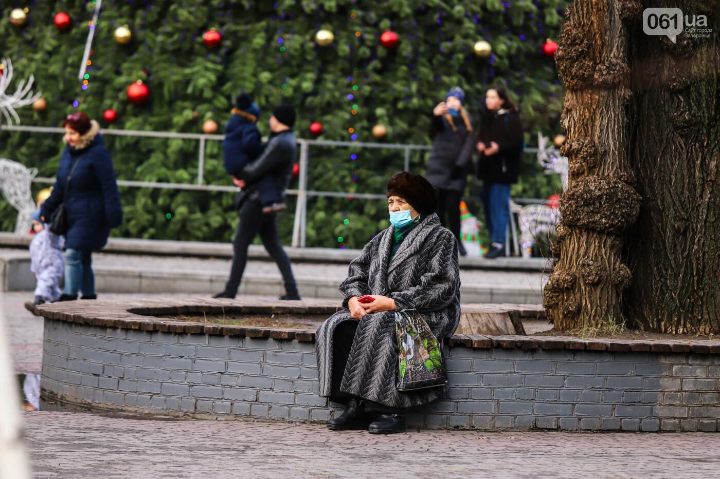 Защитные ленты на товарах, неработающие ТРЦ и полузакрытые рынки – фоторепортаж о первом дне локдауна в Запорожье, фото-41