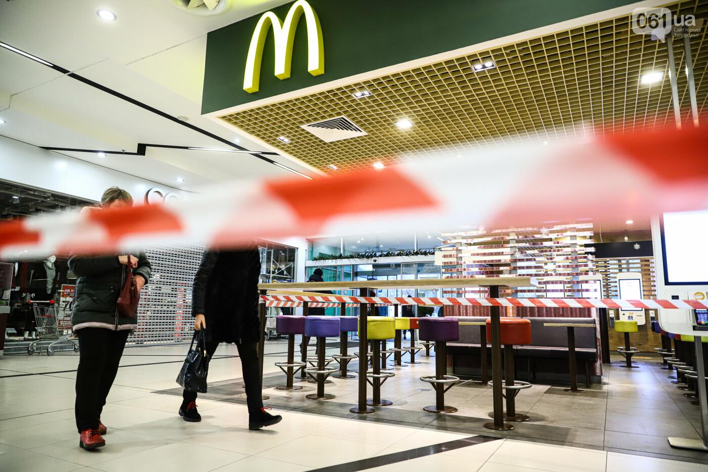 Защитные ленты на товарах, неработающие ТРЦ и полузакрытые рынки – фоторепортаж о первом дне локдауна в Запорожье, фото-28